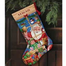 Points de croix : chaussette de Noël à réaliser, derrière la fenêtre. Réf 57/95/D08818